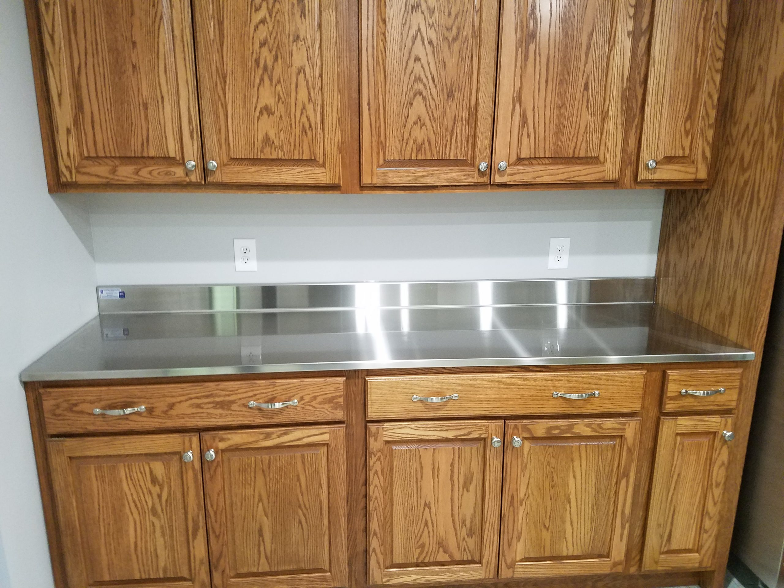 Lodge custom stainless steel counter top with rear splash