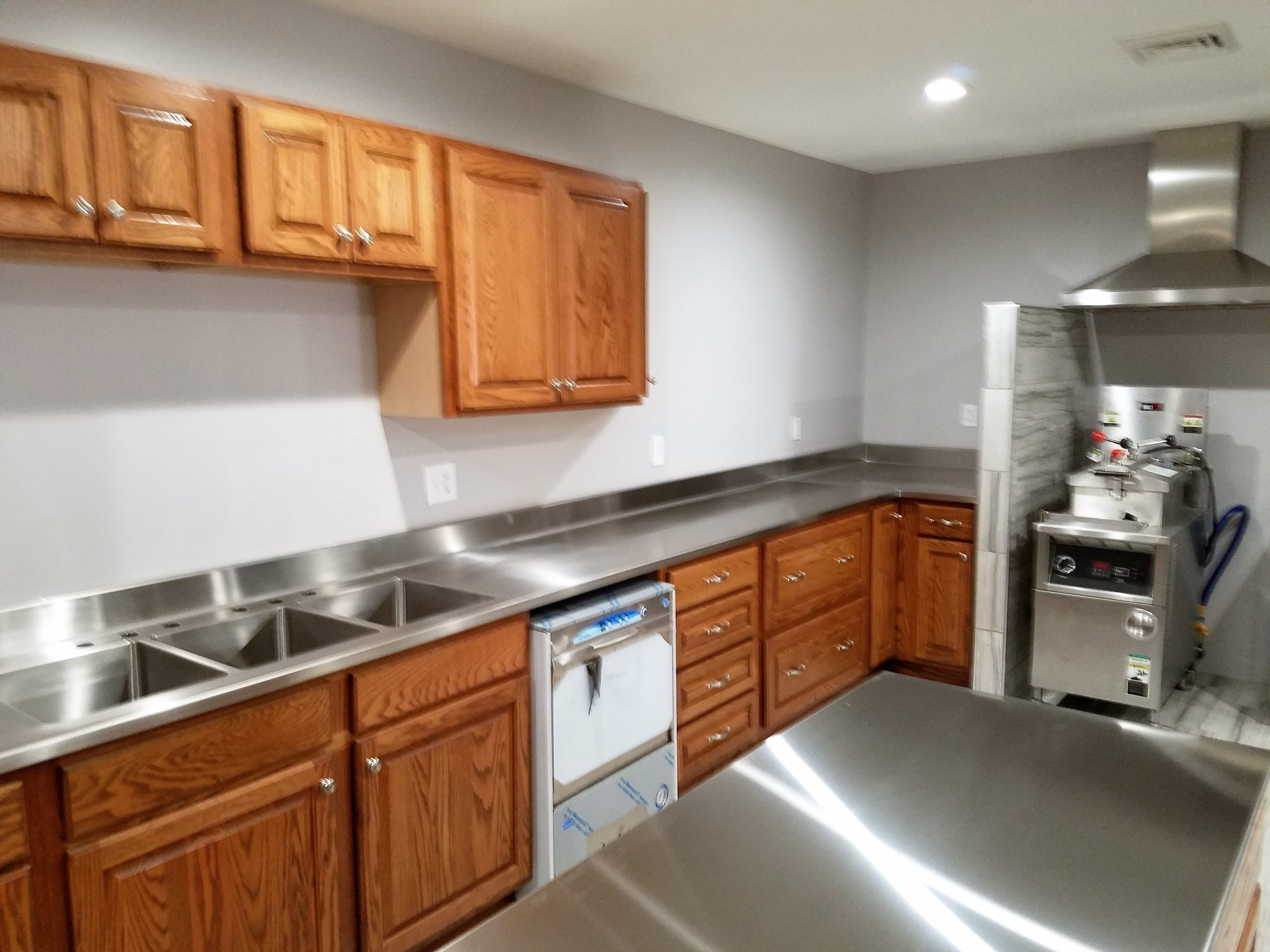 Custom Stainless Steel Top on Wood Cabinets