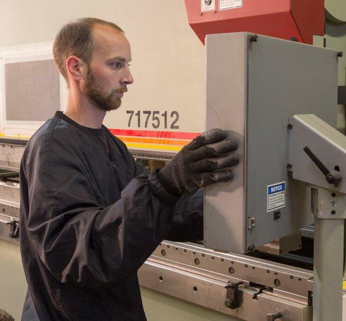 staff member working on machine