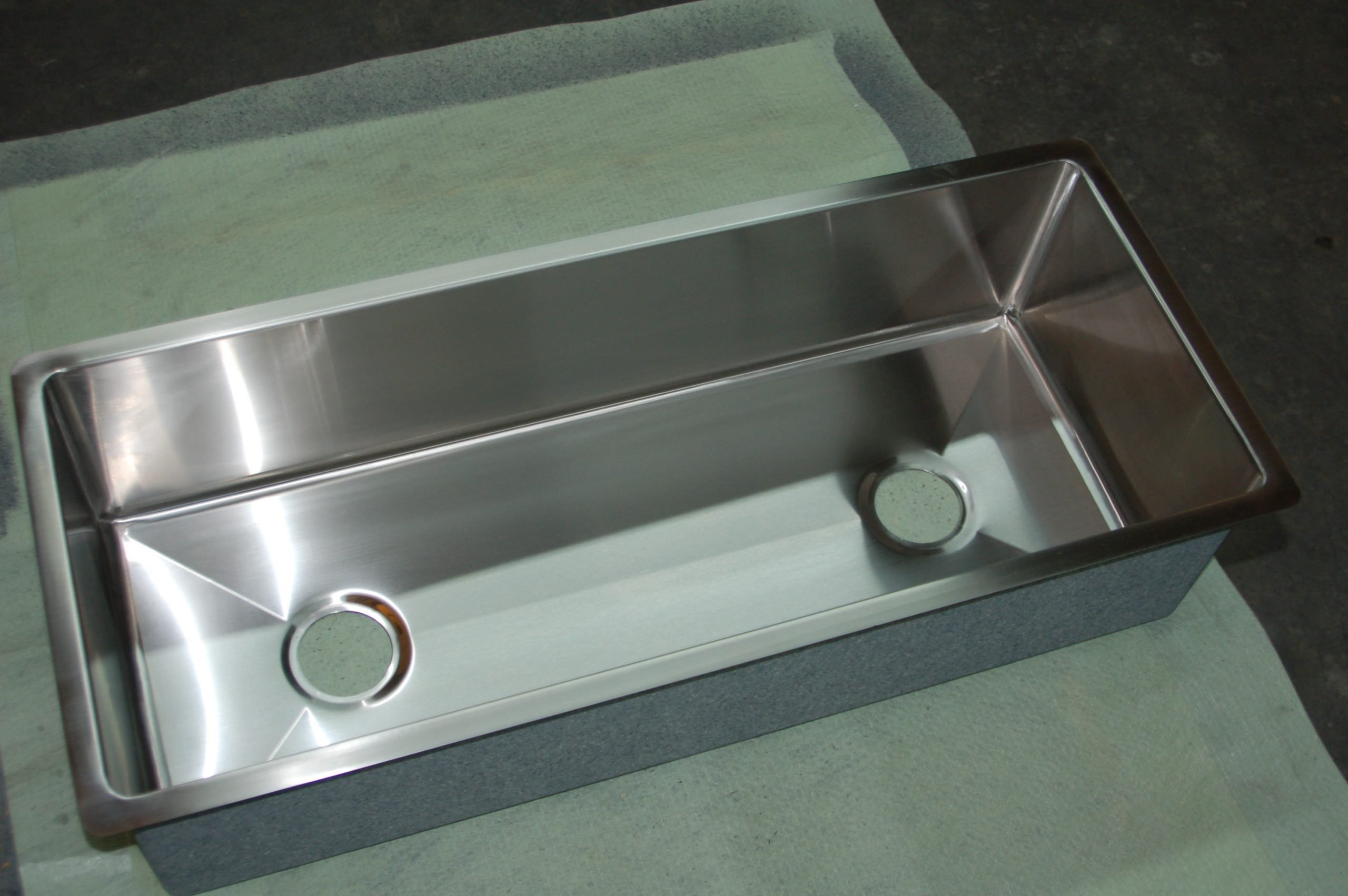 UNDERMOUNT STAINLESS STEEL CUSTOM SINK KINKED TO TWO DRAINS