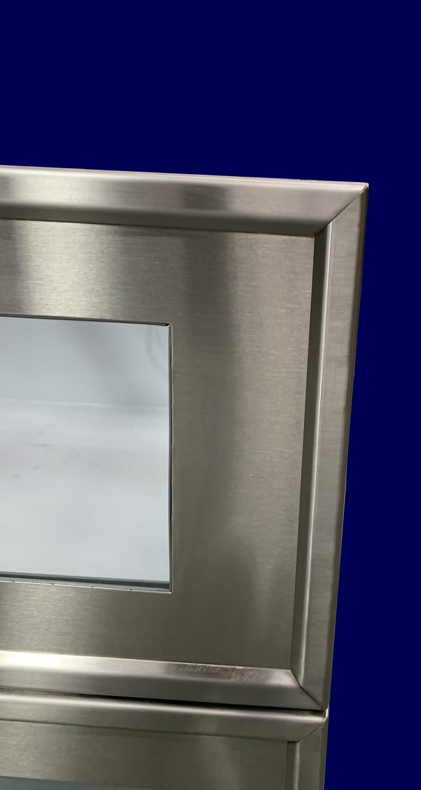Detail of stainless steel framed glass drawer front