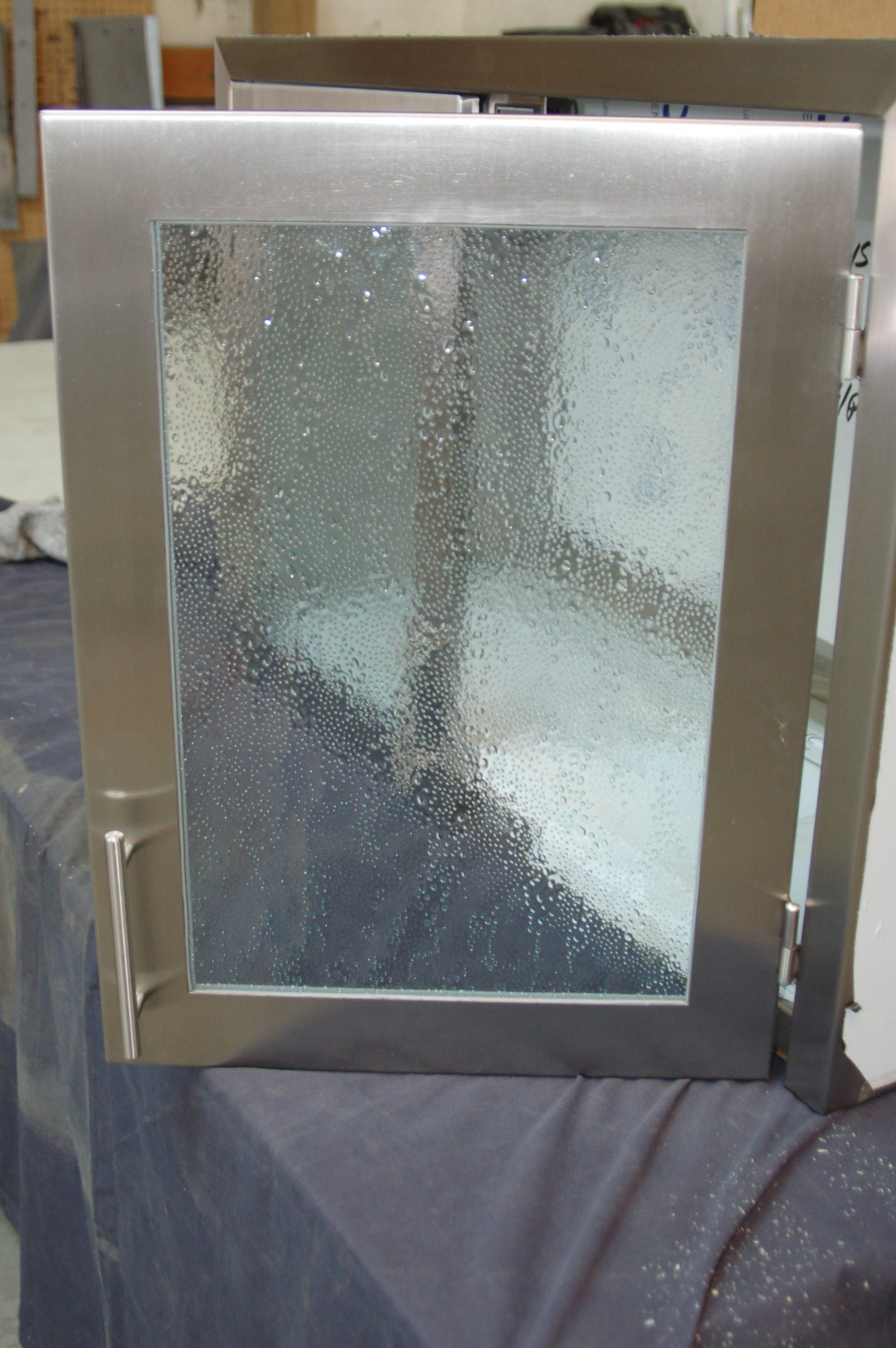 textured glass wall cabinet open door