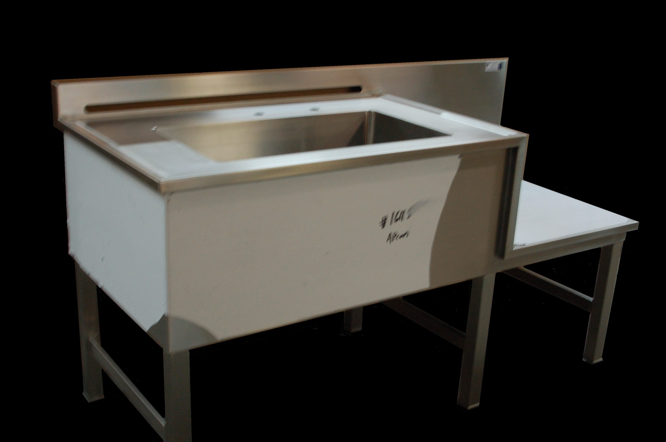 drop section vented table with integral sink