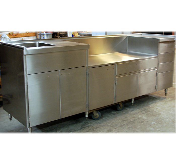 stainless steel commercial kitchen counter with base cabinets top with integral sink and multilevel work top
