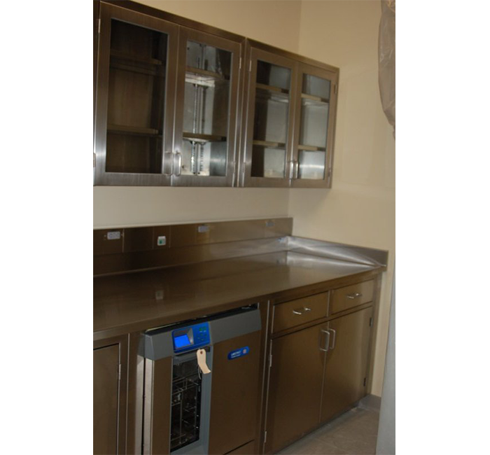 stainless steel wall cabinets with glass hinged doors and adjustable shelves with stainless steel top on stainless steel base cabinets with solid hinged doors